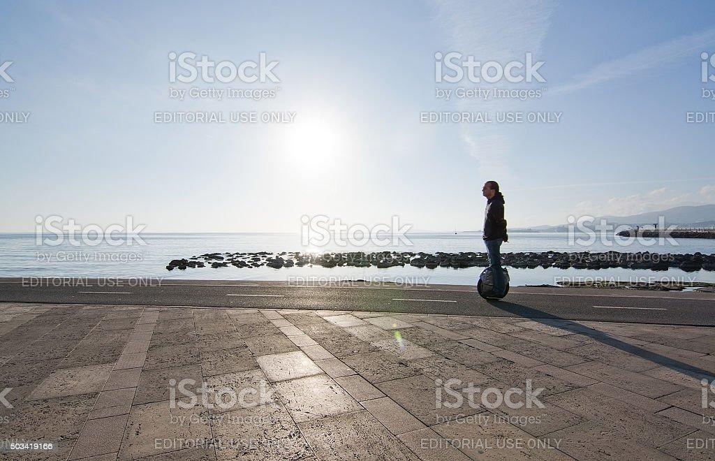 Man on solowheel in Molinar Palma stock photo