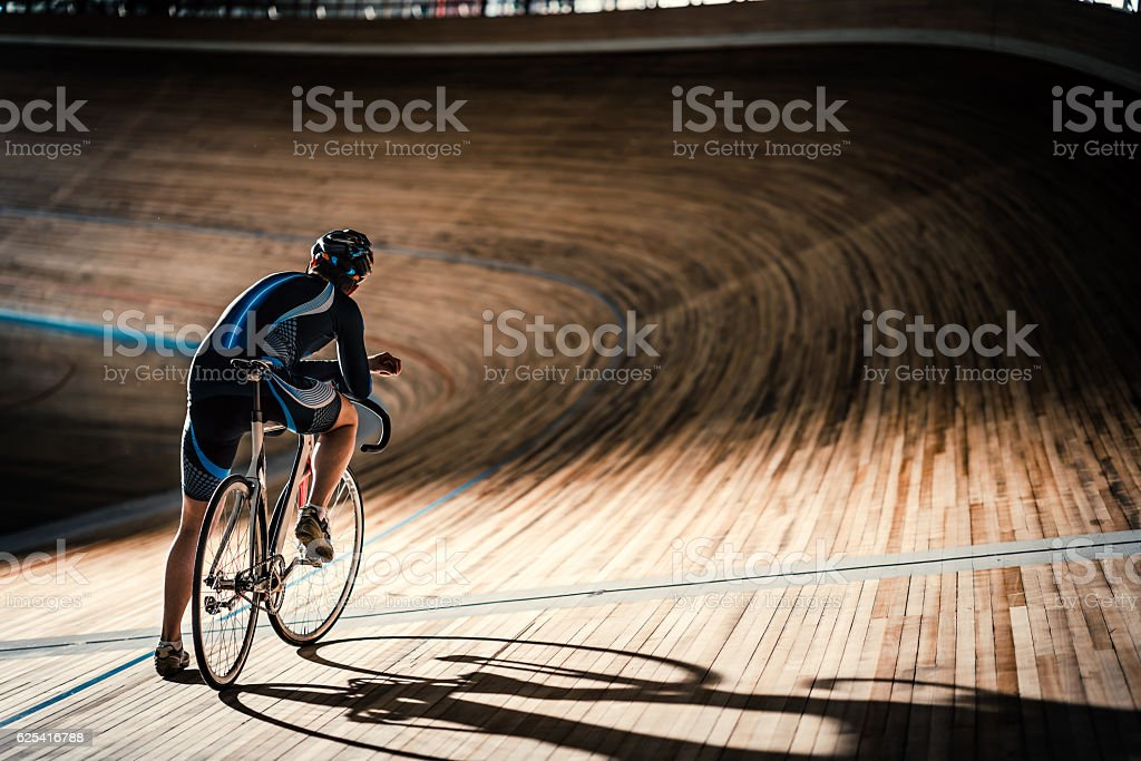 Man on sports track Man on a cycle indoors Activity Stock Photo