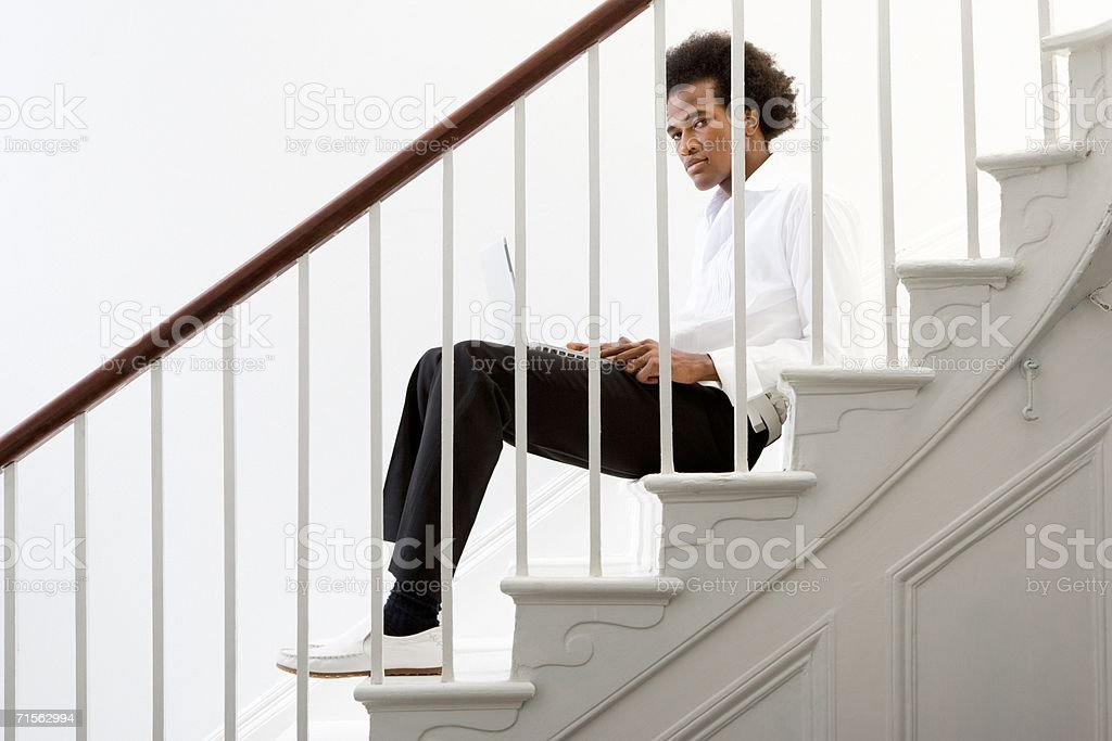 Man on stairs with laptop computer royalty-free stock photo