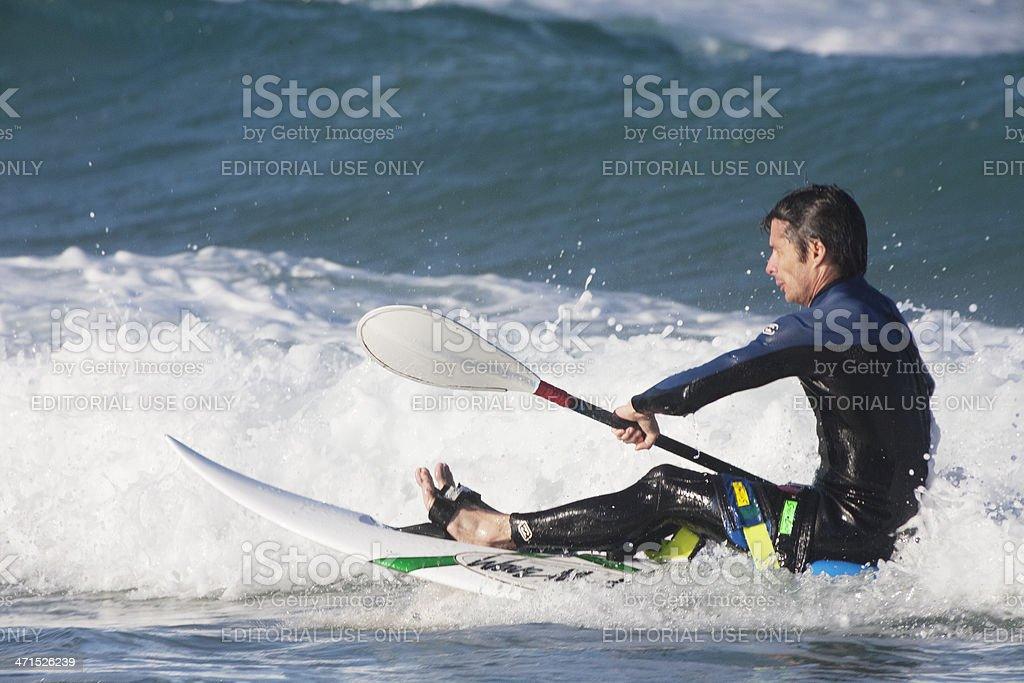 Man on surfing kayak royalty-free stock photo