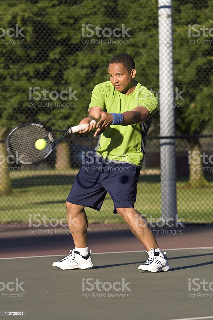 Man on Tennis Court About to Hit a Forehand royalty-free stock photo