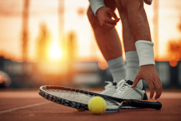 Man on tennis court, close up stock photo
