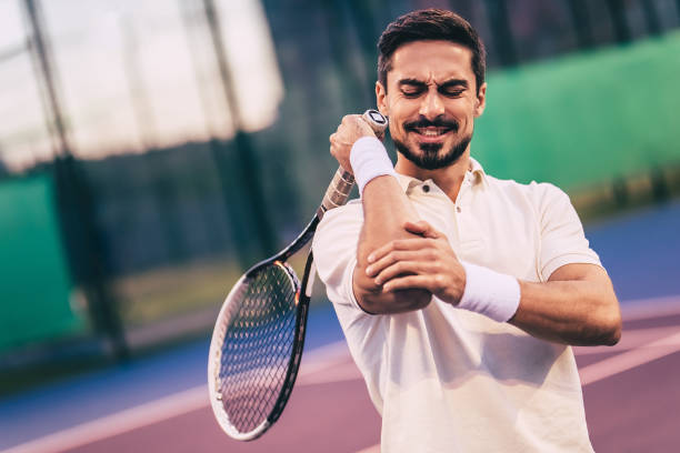 man on tennis court. - tennis stock pictures, royalty-free photos & images