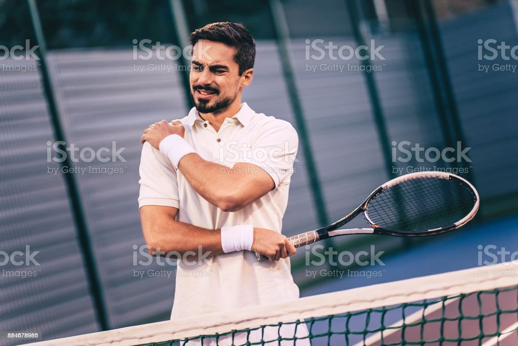 Man on tennis court. stock photo