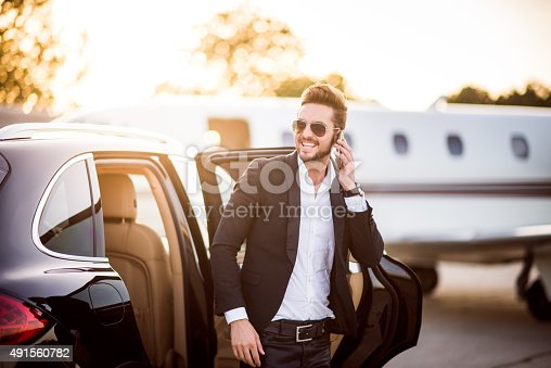 istock Man on the airport with phone in his hand 491560782