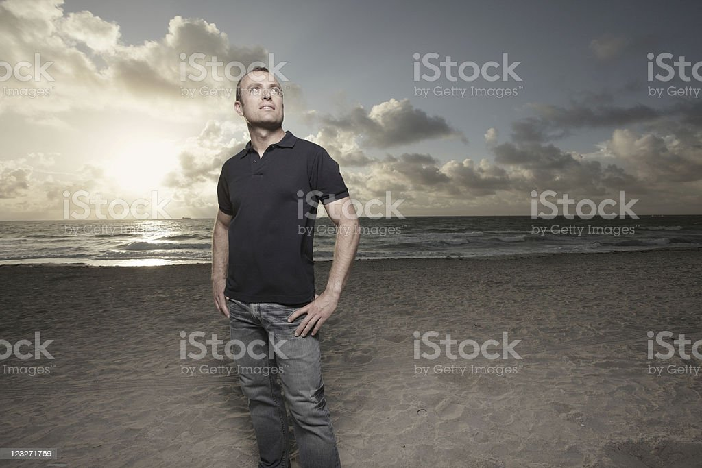 Man on the beach during sunrise royalty-free stock photo