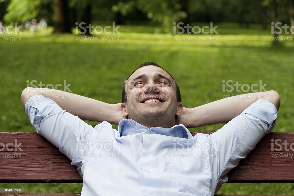 Man on the bench stock photo