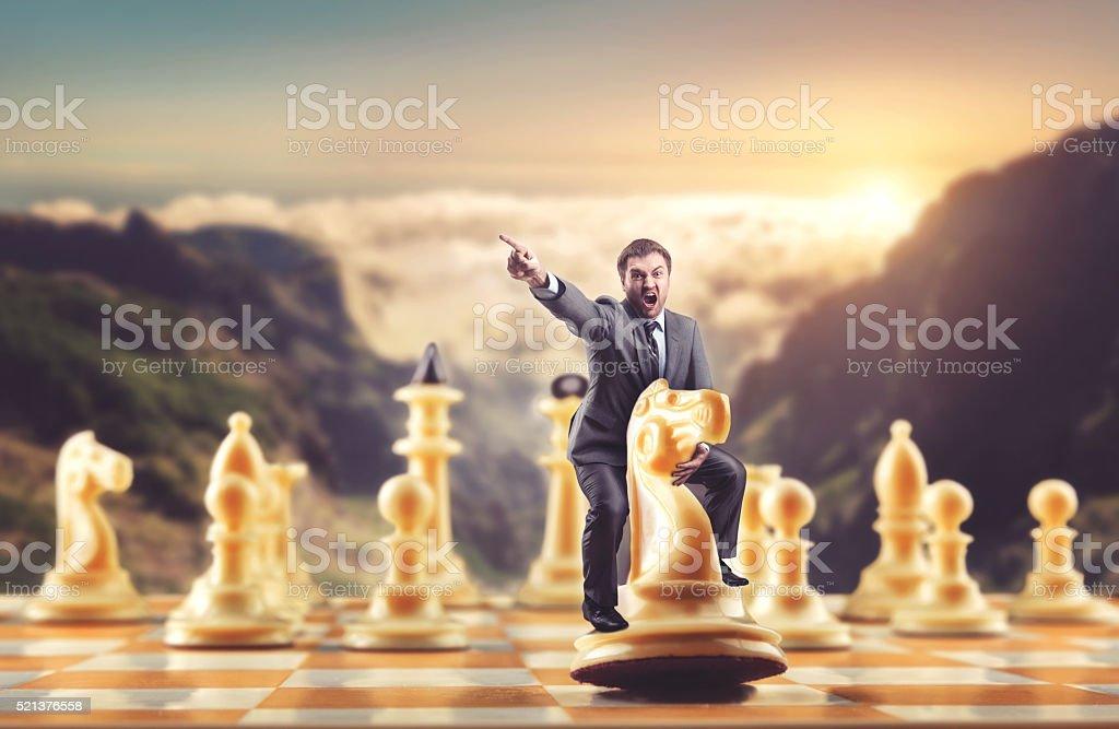 Man on the chess figure stock photo