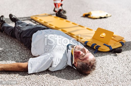 508966965 istock photo man on the ground after a car crash 937723698