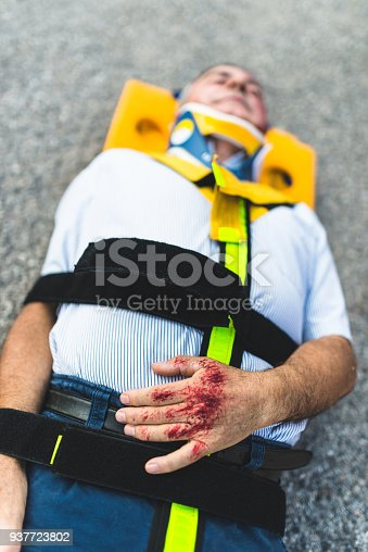 508966965 istock photo man on the ground after a car crash 937723802