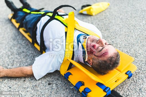 508966965 istock photo man on the ground after a car crash 938819226