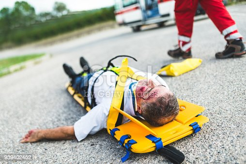 508966965 istock photo man on the ground after a car crash 939402452