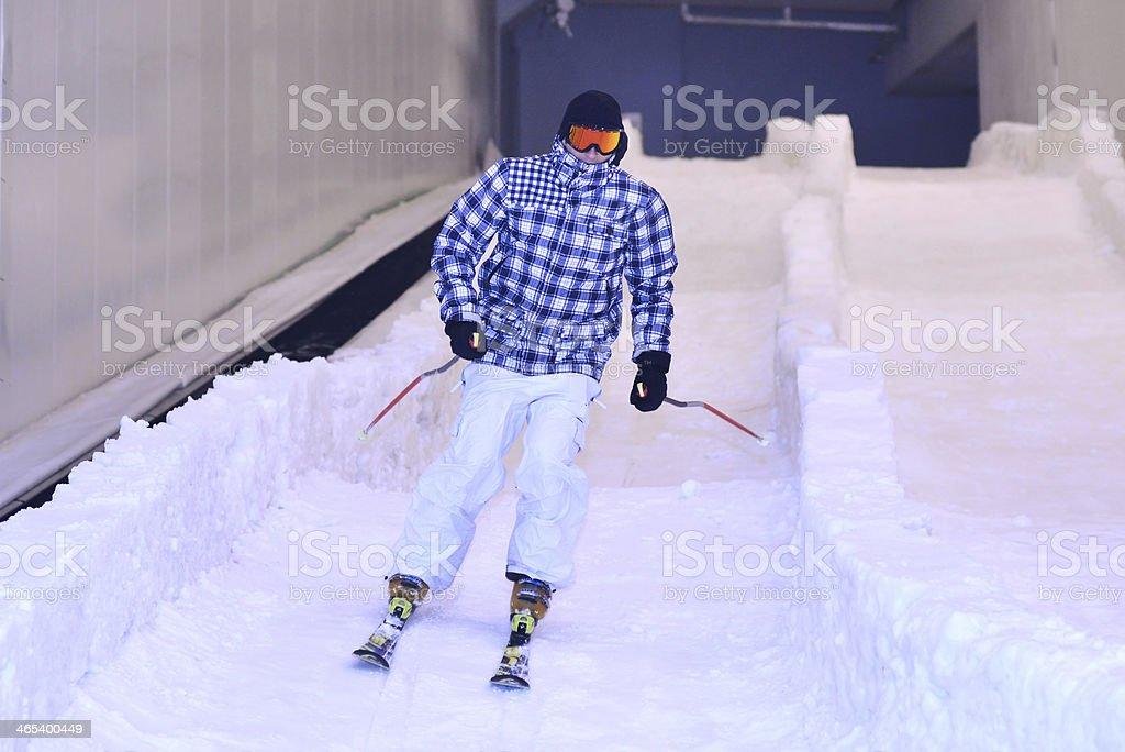 Man on the indoor ski slope stock photo