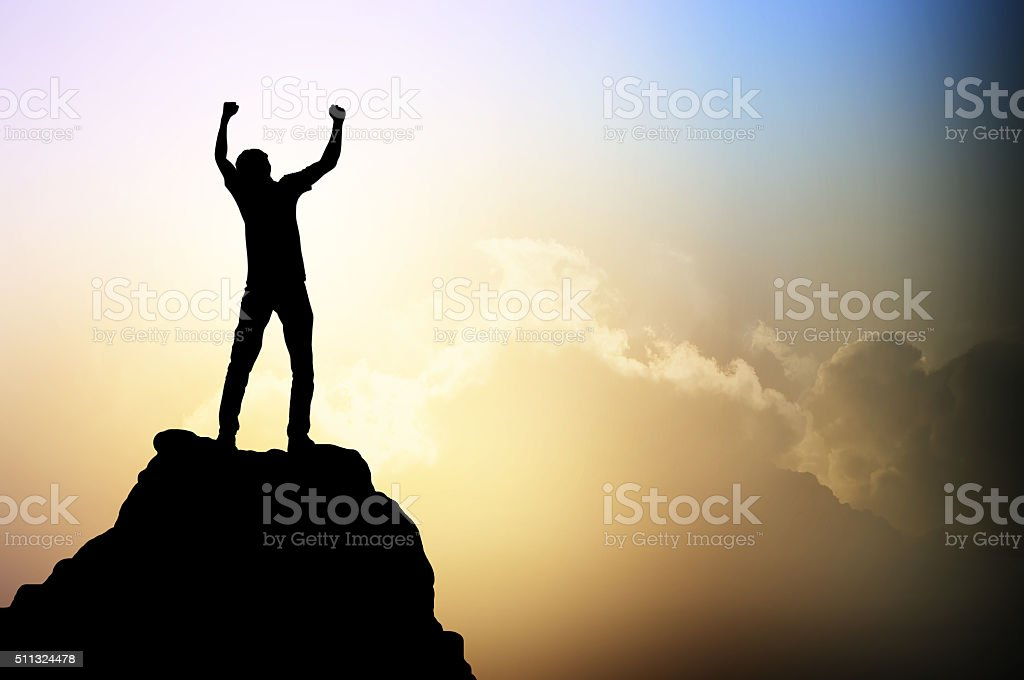 Man on the peak of mountain stock photo