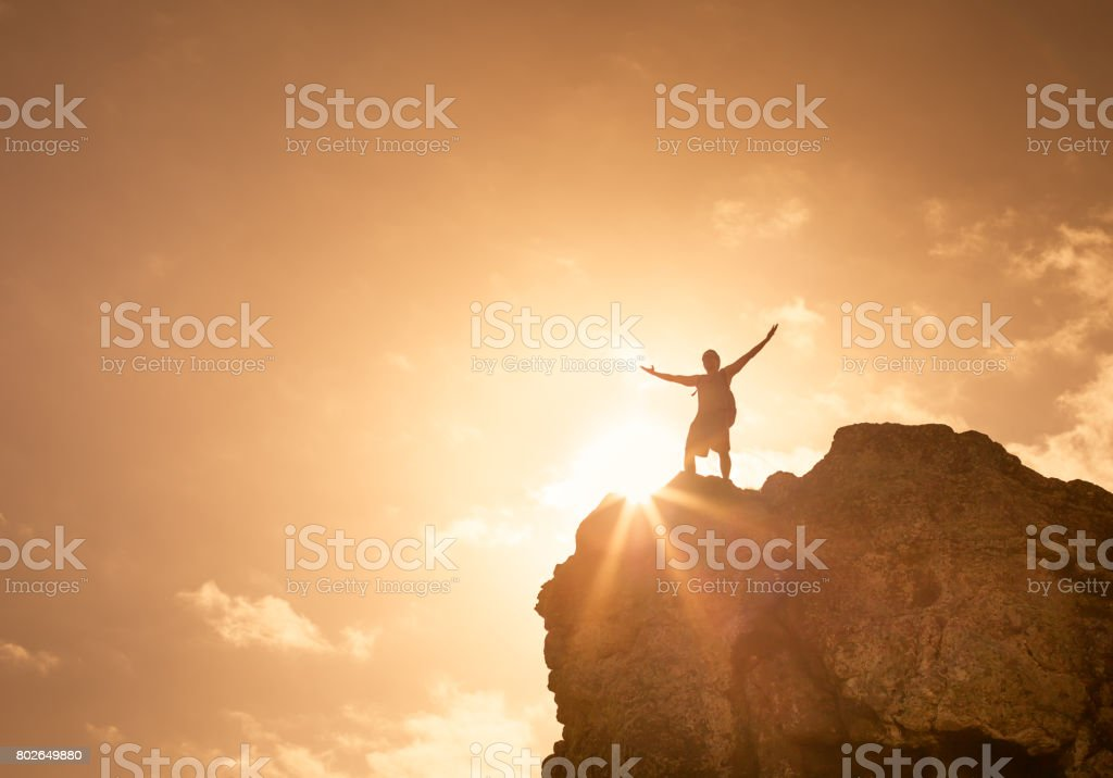 Man on the peak of the mountain stock photo