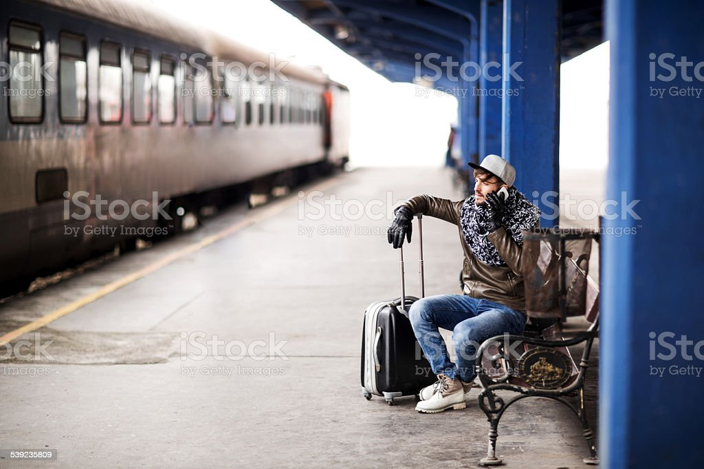 Man on the phone at train station. royalty-free stock photo
