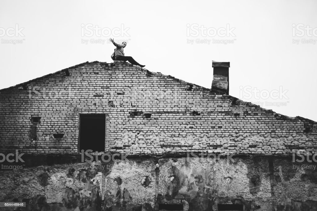 Man On The Roof Of Abandoned Building Stock Photo Download Image Now Istock