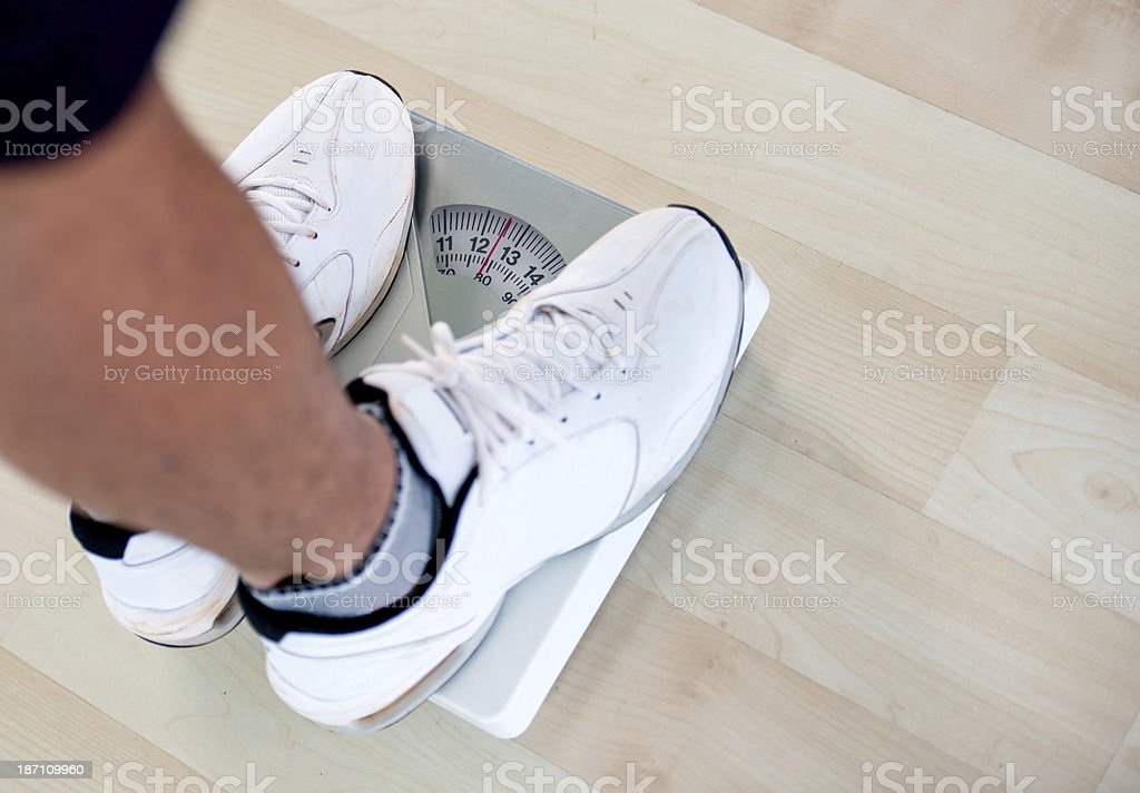 Man on the scale royalty-free stock photo