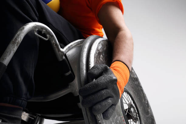 man on the sports wheelchair - wheelchair sports stock photos and pictures