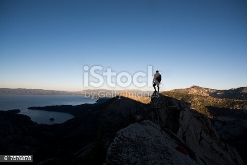 Man overlooking Lake Tahoe and Emerald Bay from a high mountain top