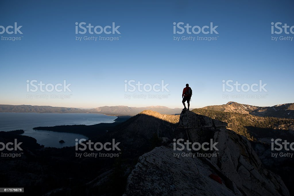 Man on the summit of a mountain, Lake Tahoe stock photo