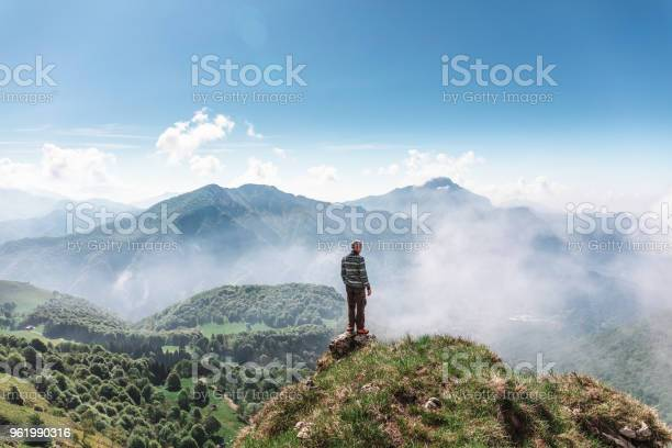 Photo of Man on the top mountain lokking away