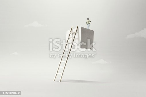 istock man on the top of a suspended cube observing the future, surreal concept 1158150408
