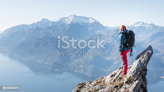 istock man on the top of the mountain peak 904084674