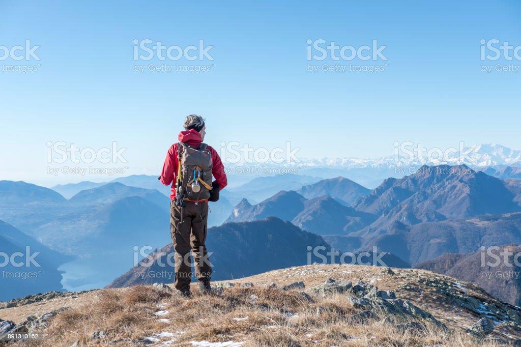 Man on the top of the mountain range stock photo