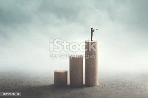 ambitious man climbs to the top to see far
