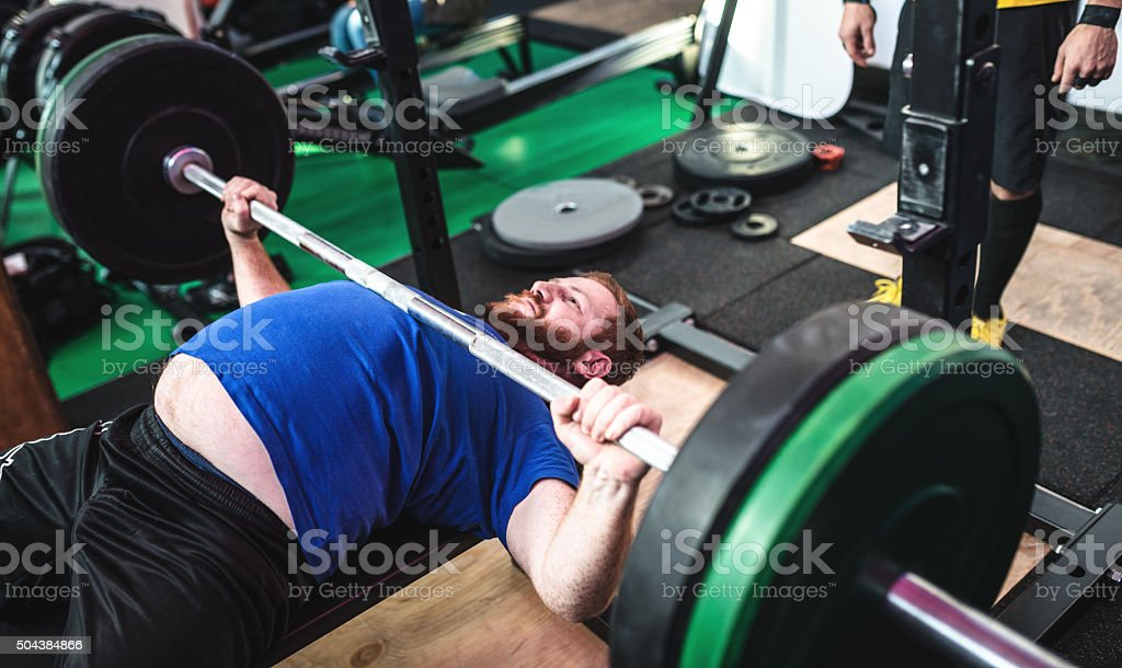 Man on the weight bench stock photo