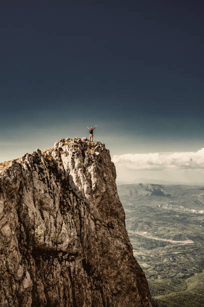 man on top of a mountain - milan2099 stock photos and pictures