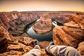 Man living on the edge at the horseshoe bend. Page, Arizona. USA