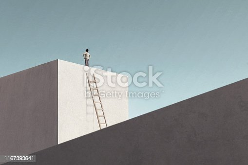 istock man on top of minimalist structure observing the sky 1167393641