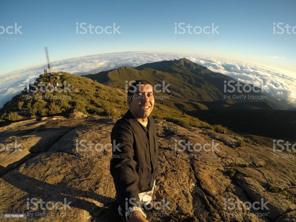 Man on top of mountain stock photo