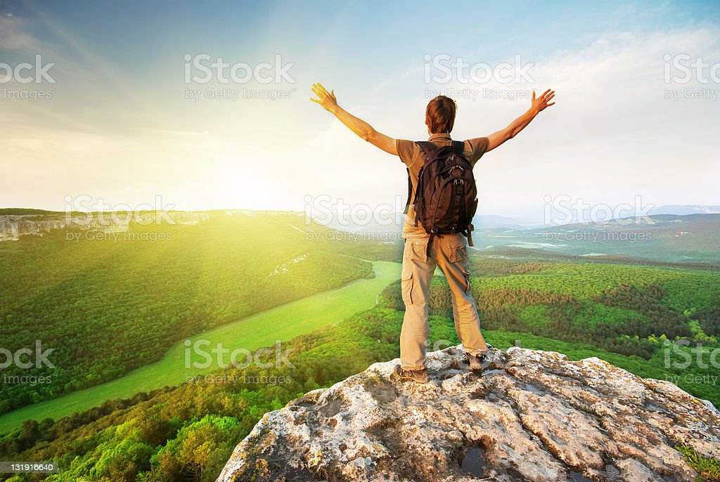 Man on top of mountain royalty-free stock photo
