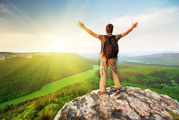 Man on top of mountain stock photo