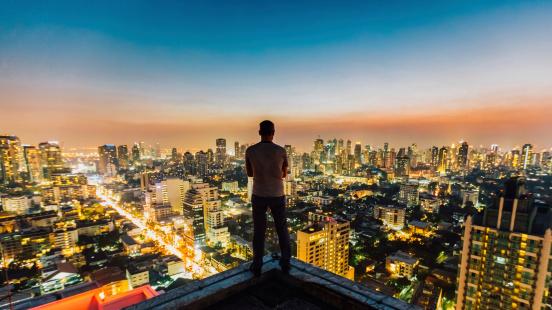 istock Man on top of skyscraper 488719189
