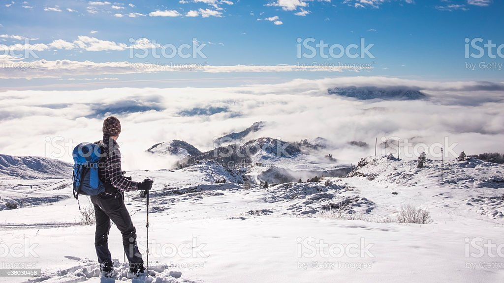 Man on top of the mountain snowy stock photo