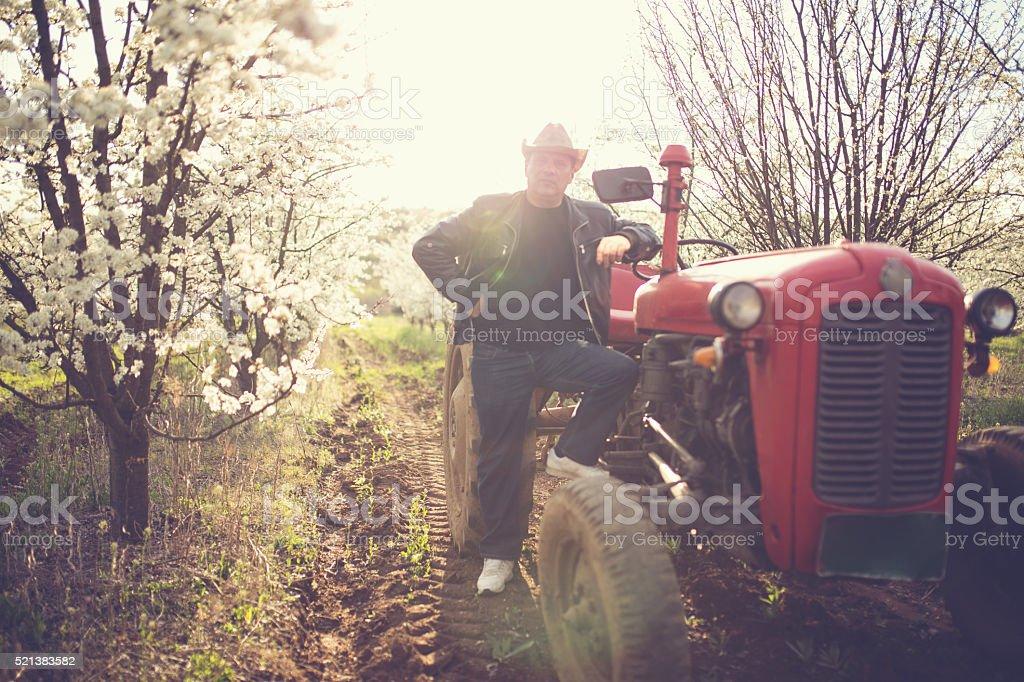 Man on tractor stock photo