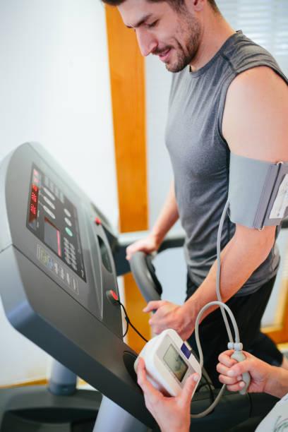 Man on treadmill running stock photo