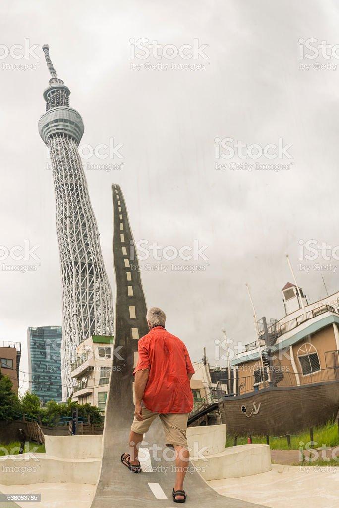 Man on virtual road in Japan. stock photo