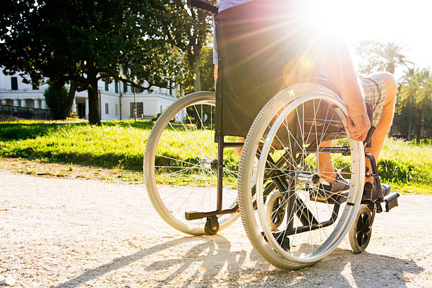 Man on wheelchair in a park - foto de stock