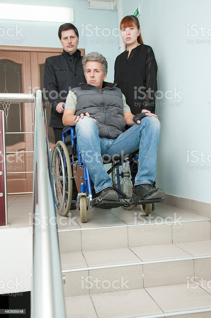 Man on wheelchair stock photo
