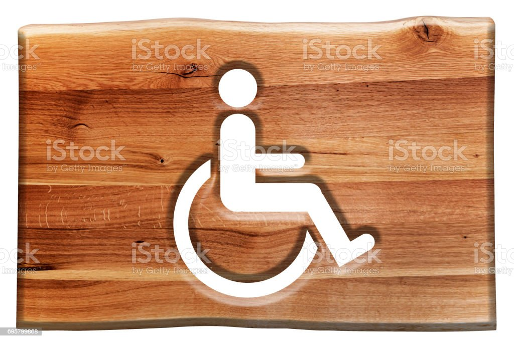Man on wheelchair sign, symbol of handicapped, disabled person in wooden board. stock photo