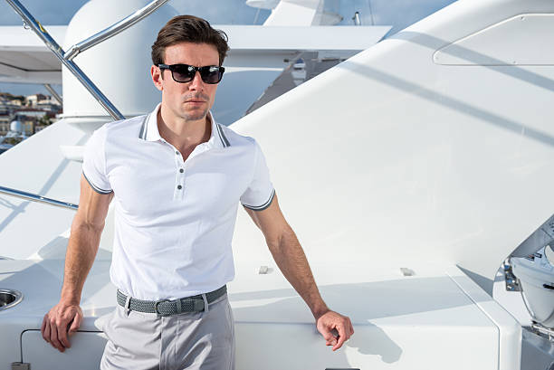 man on yacht - preppy fashion stock photos and pictures