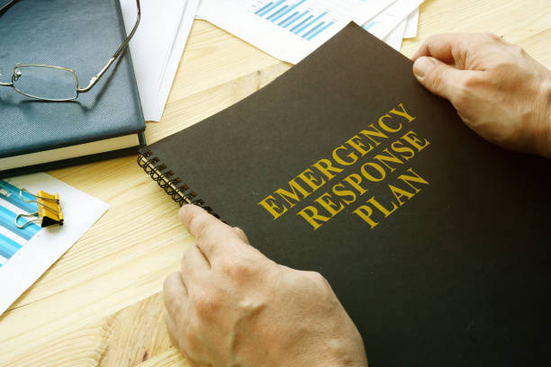 Man open disaster and emergency response plan for reading. stock photo