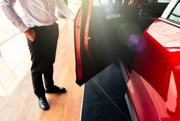 man open red car door with smart keyless For automotive or transportation image man open red car door with smart keyless For automotive or transportation image alongside stock pictures, royalty-free photos & images