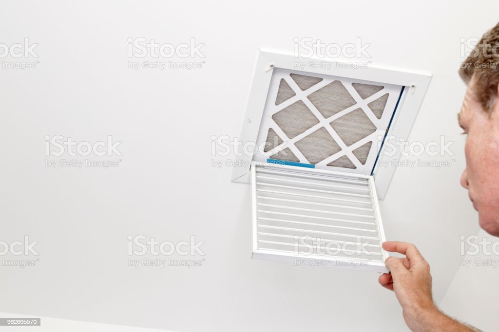 Man Opened a Vent to a Dirty Filter stock photo