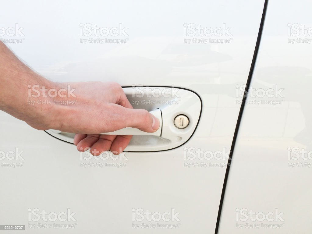 Man opening Car Door stock photo